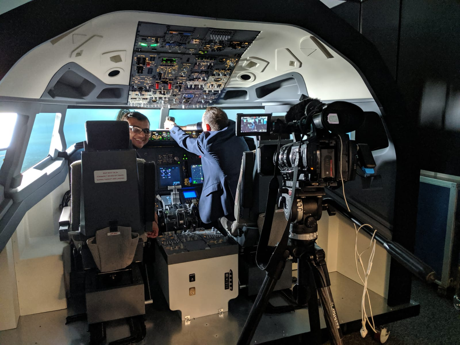Film Crew Filming Flight Simulator Cockpit